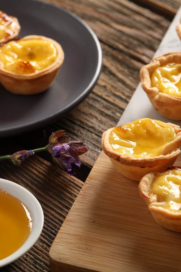 Recipe for Chinese egg tarts created by Chef Edward Lee. These sweet and savory puff pastry bites are filled with eggs, evaporated milk, and honey. | peteandgerrys.com