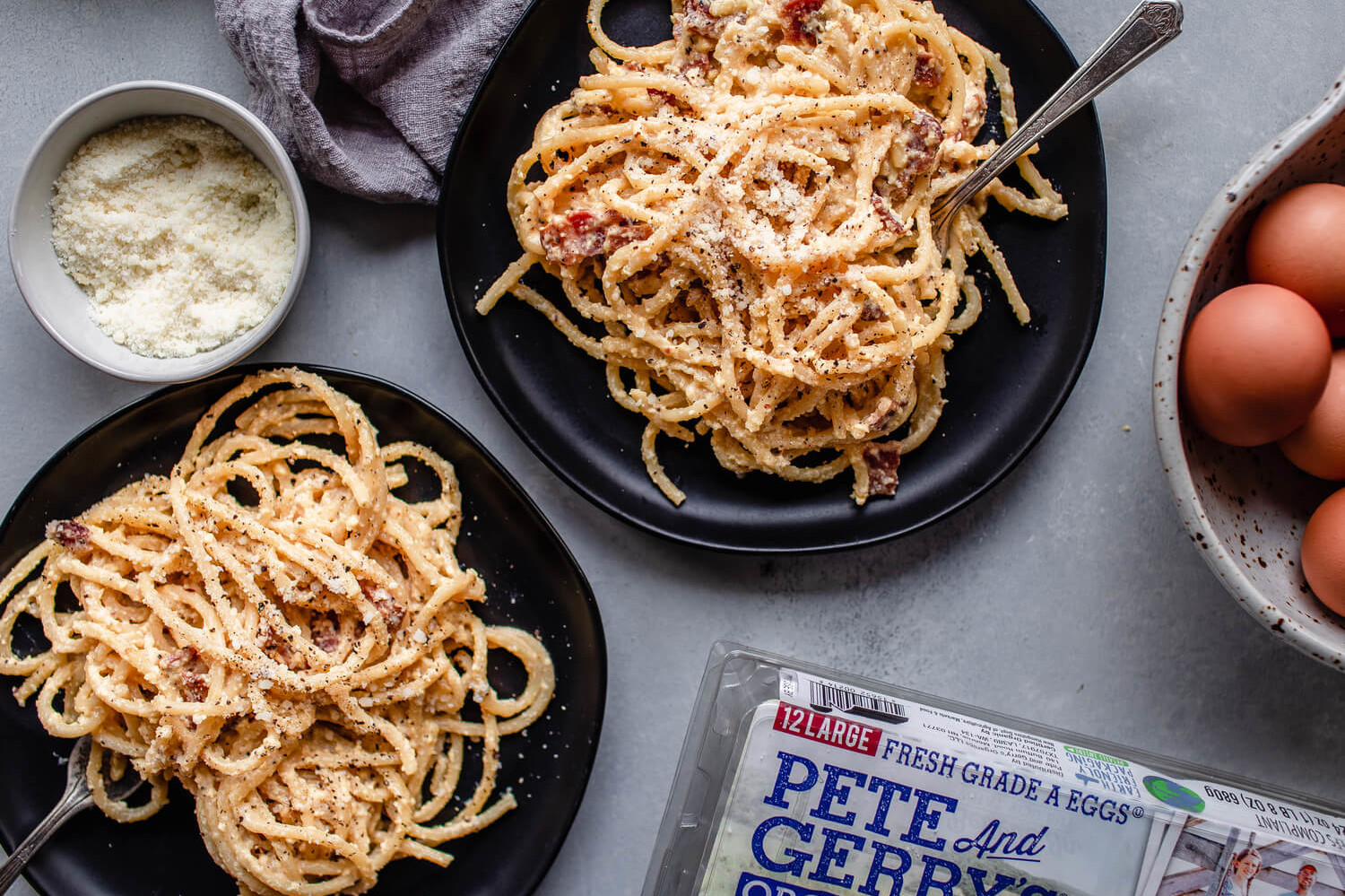 This pasta carbonara is a classic, thanks to the delicious and rich, egg-based sauce. We topped our pasta with parmesan cheese, diced bacon, and fresh black pepper. | peteandgerrys.com