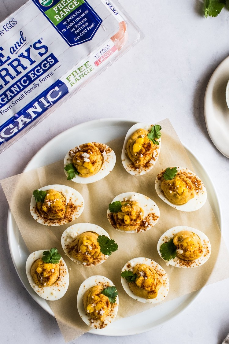 Mexican street corn inspired deviled eggs recipe made with cotija cheese, chili powder, and creamy mayonnaise. | peteandgerrys.com