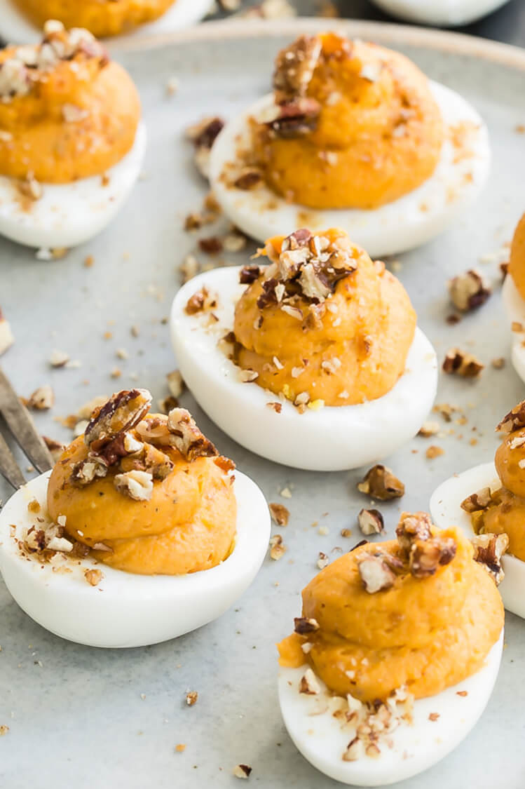 These deviled eggs are made with a fall twist. Pictured is our sweet potato deviled eggs which are made with mascarpone cheese, sweet potatoes, pecans, and brown sugar. | peteandgerrys.com