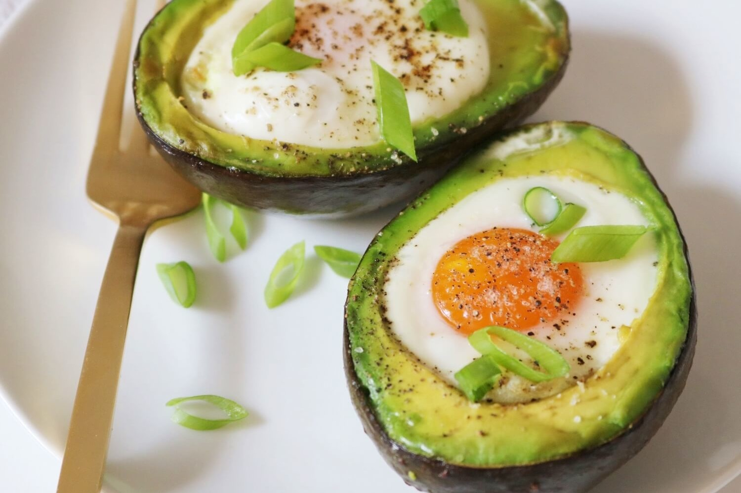 A recipe for avocado egg boats by dietitian Keri Glassman. Avocado is halved, and each half is filled with an organic egg and baked for a nutritious combination of protein and healthy fats. | peteandgerrys.com
