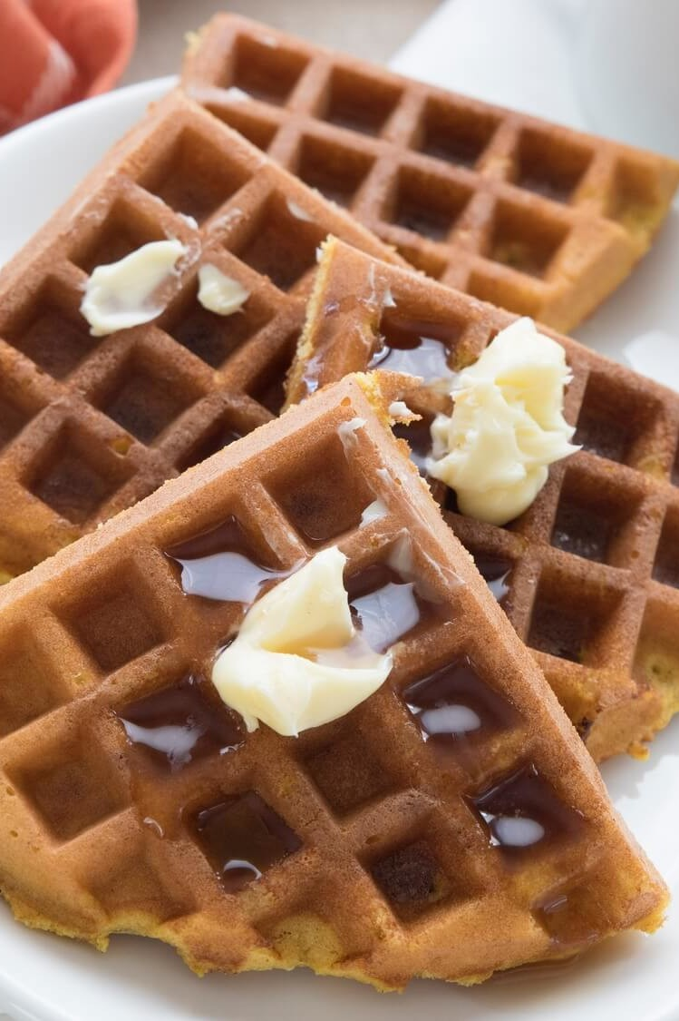 These keto-friendly pumpkin protein waffles are made with organic eggs, pumpkin puree, almond flour, and butter. Our waffles are topped with maple syrup and soft butter. | peteandgerrys.com