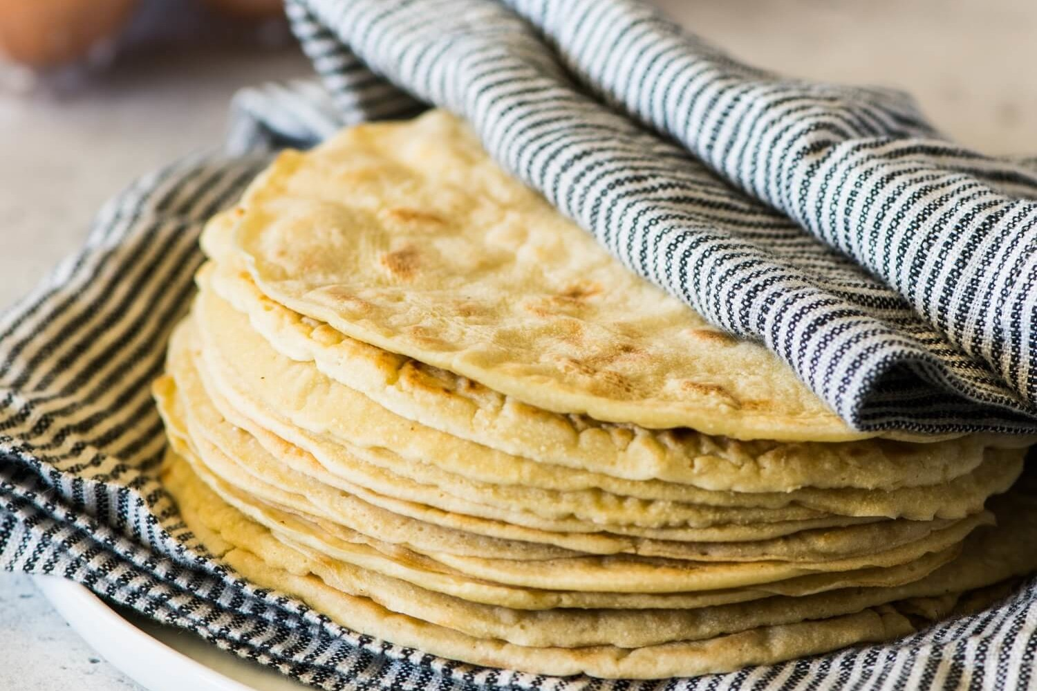 These paleo tortillas are made with coconut flour, tapioca, sea salt, almond milk, and organic brown eggs. | peteandgerrys.com