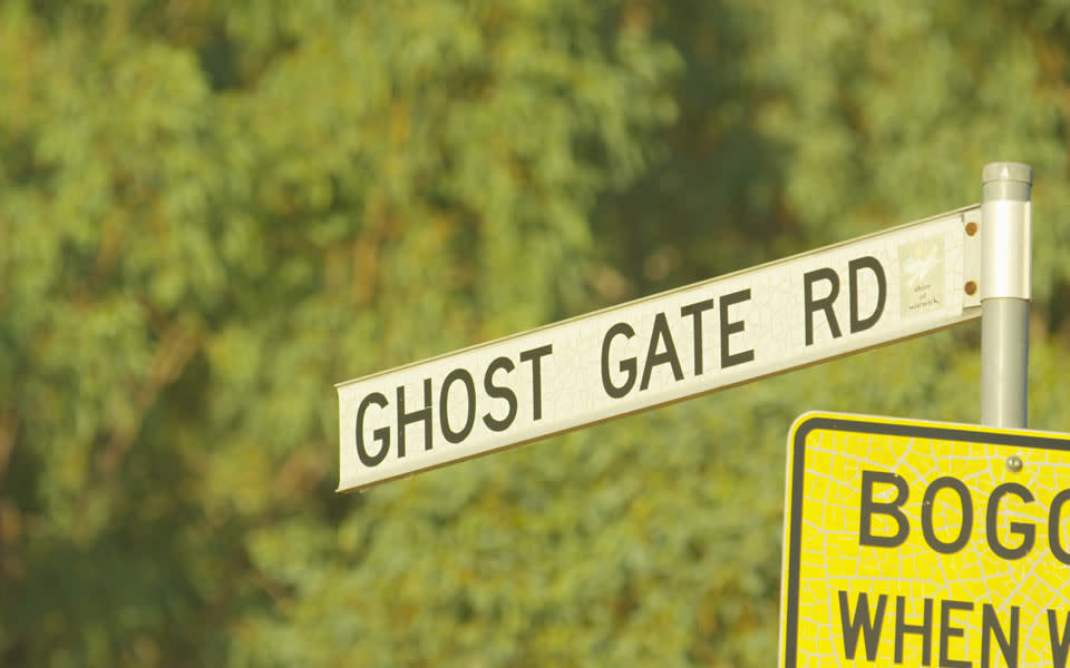 The road sign for Ghost Gate Road