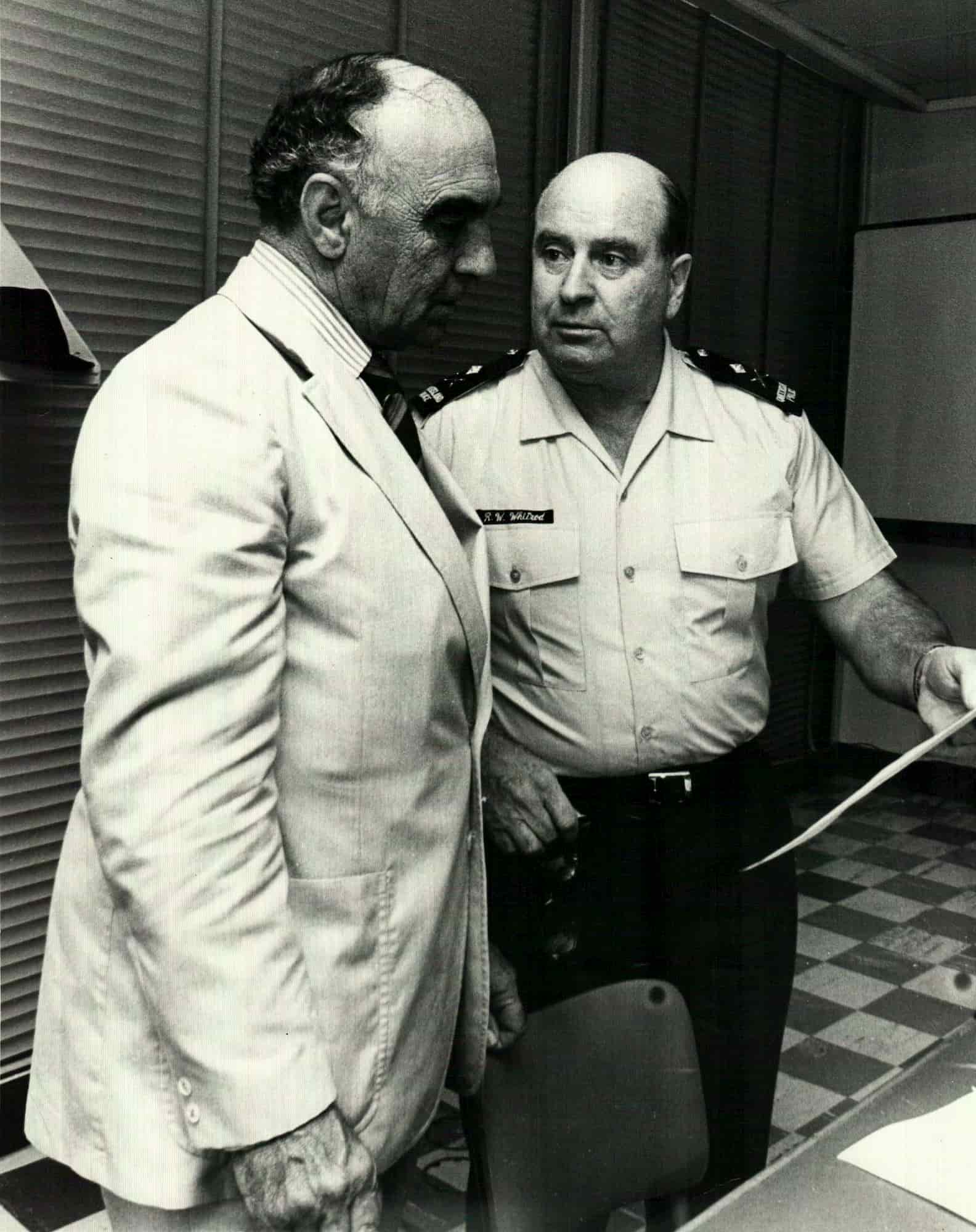 Journalist Brian Bolton warned Commissioner R. Whitrod (right) of the plans to firebomb the Whiskey Au Go Go, but Queensland Police didn't listen.