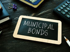 Municipal bonds on a black board
