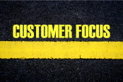 CUSTOMER FOCUS ON ASPHALT BACKGROUND