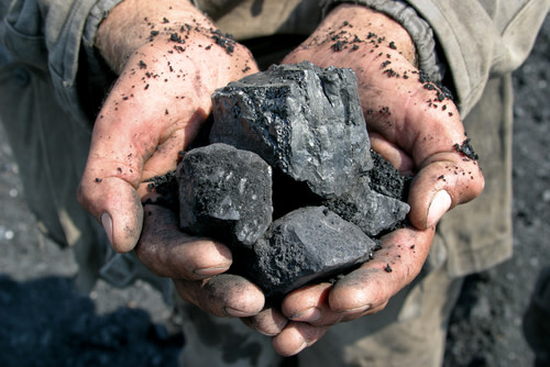 Holding Coal in Hands
