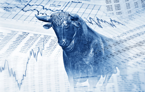 Financial documents, graphs, and a silver bull.