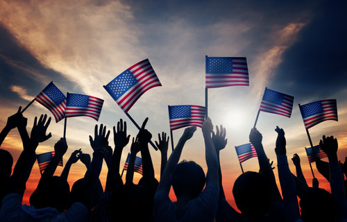 Group of people waving American Flags
