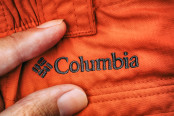 Embroidered logo Columbia on red clothes