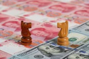 Chess Pieces on Yuan and Dollar