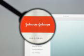 "A magnifying glass focusing on ""Johnson & Johnson""."