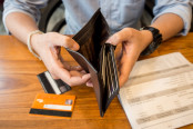 Man Holding Empty Wallet Open - Credit Card Debt