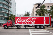 Coca-Cola text on a truck