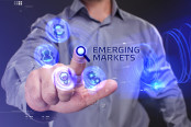 "Man pointing at image placed beside the word ""Emerging Market"""