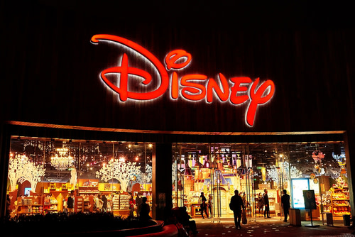 A large Disney sign over a store.