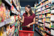 Woman Browsing Packaged Food Aisle