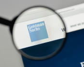Goldman Sachs logo under magnifying glass
