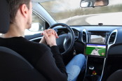 A man in an autonomous driving test vehicle