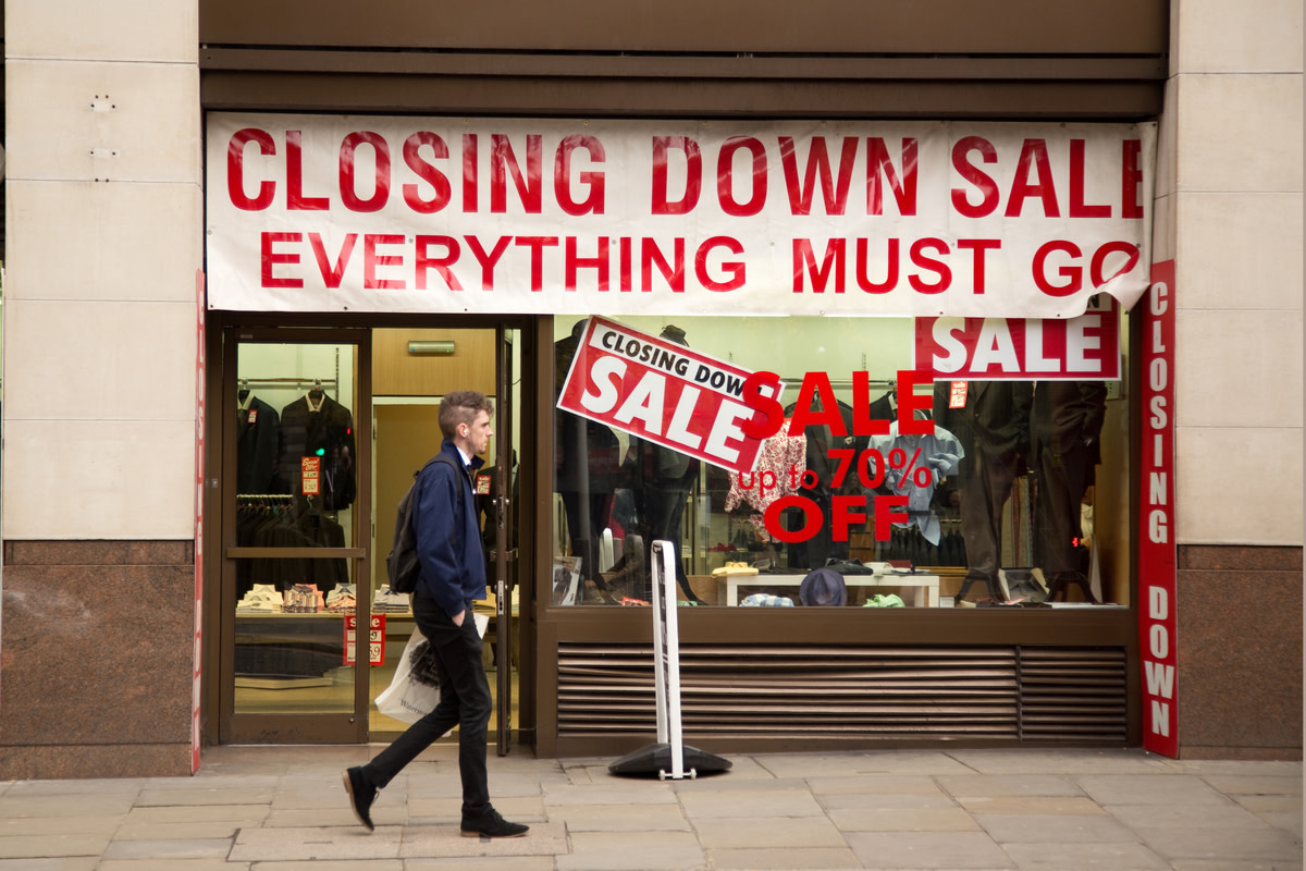 Closing down sale sign in a shop window