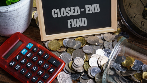 Closed-end fund on a chalboard with a calculator and coins