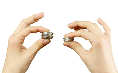 Two hands holding piles of coins
