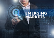"Business man behind text that reads ""Emerging Markets"""