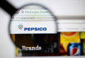 PepsiCo logo looked through a magnifying glass