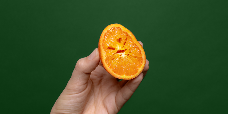 Orange squeezed in hand