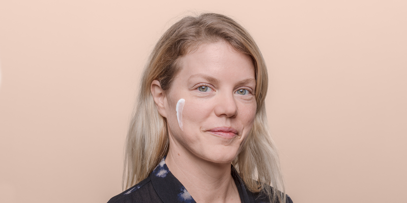 Women with cream product on cheek