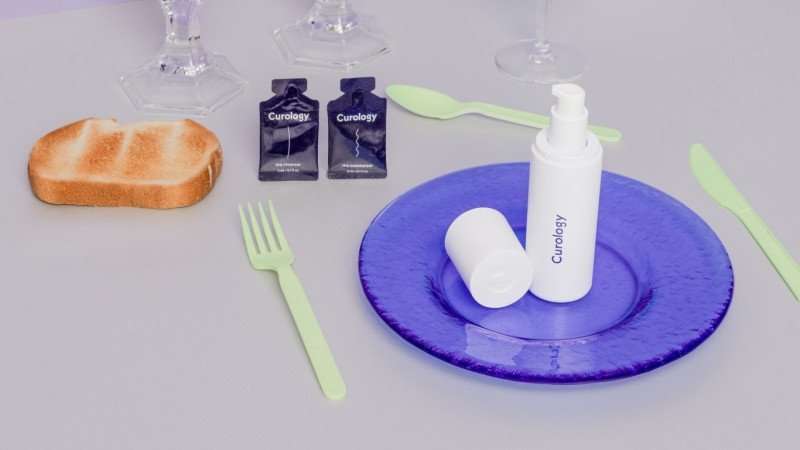 Curology bottle on plate by toast
