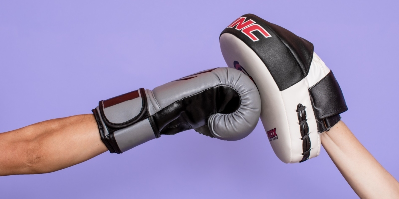 Boxing gloves with purple background