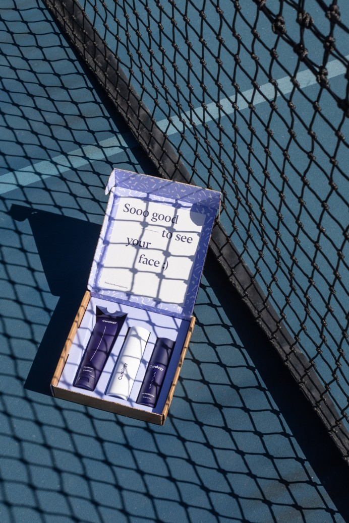 Curology box by tennis net