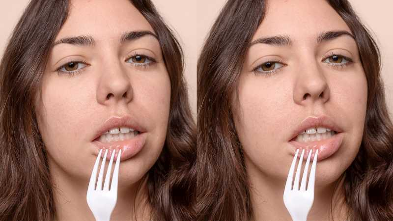 Woman with fork on her lip