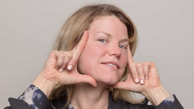 Woman holding fingers to frame her face