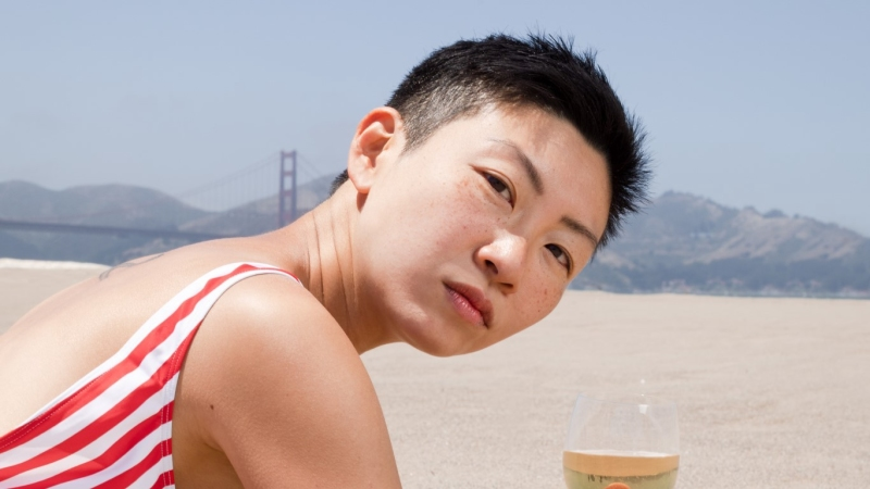 Woman at the beach in front of golden gate bridge