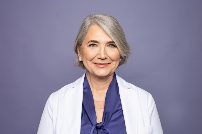 Dr. Nancy Satur in front of purple background