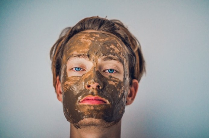 Clay mask on persons face