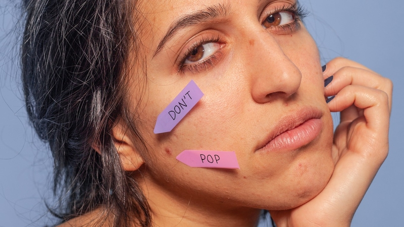 Woman with sticky note on face saying