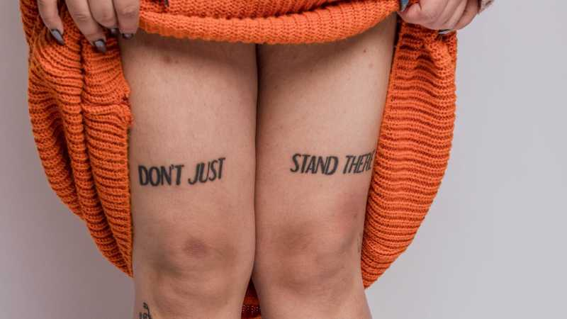 Don't just stand there tattoo on legs