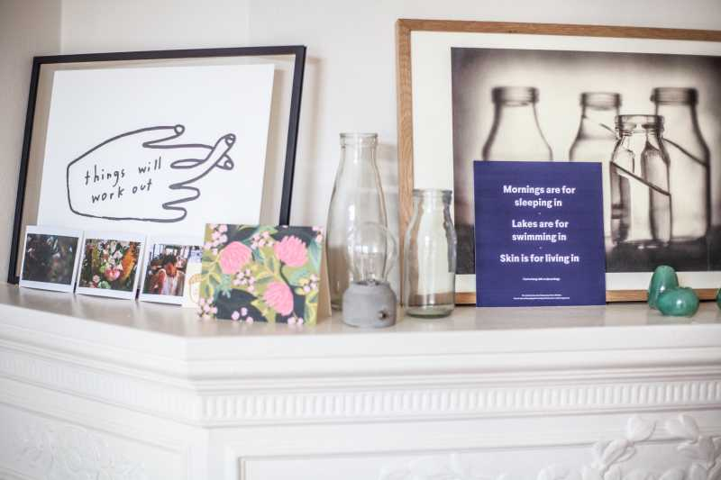 Image of shelf in home with images, bottles, and