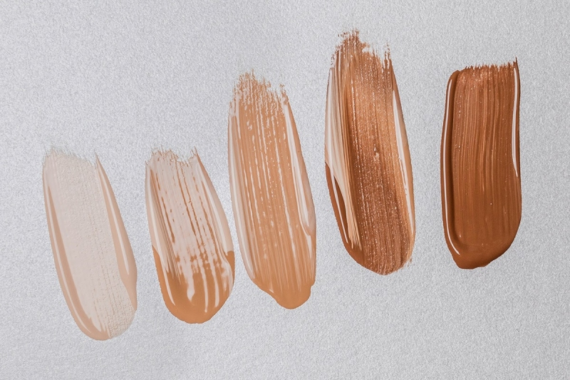 Swatches of 5 different shades of concealer, organized from lightest to darkest.