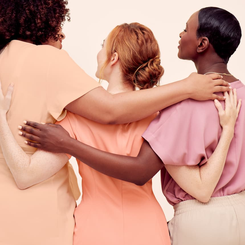 a diverse group of women hugging