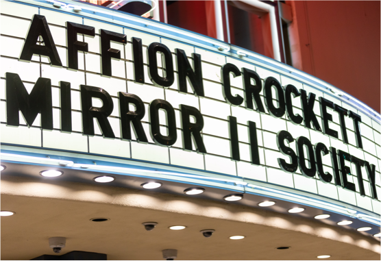 affion crockett marquee sign at theater