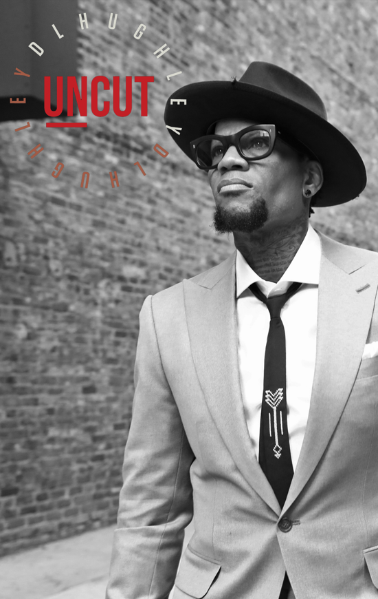 dl uncut, dl hughley, king of comedy, in a suit with a hat
