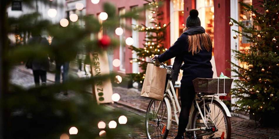 Girl riding a bicycle in Oslo Christmas street