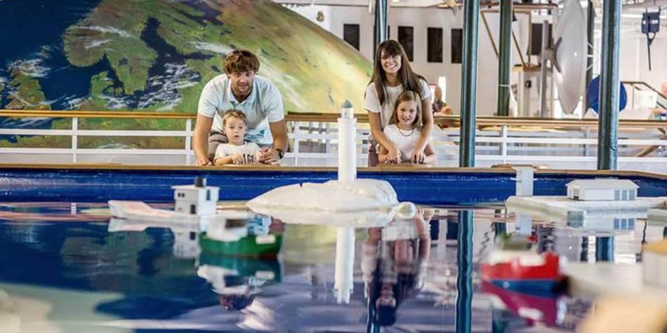 Family enjoying an exhibition at Kreativum Science Centre