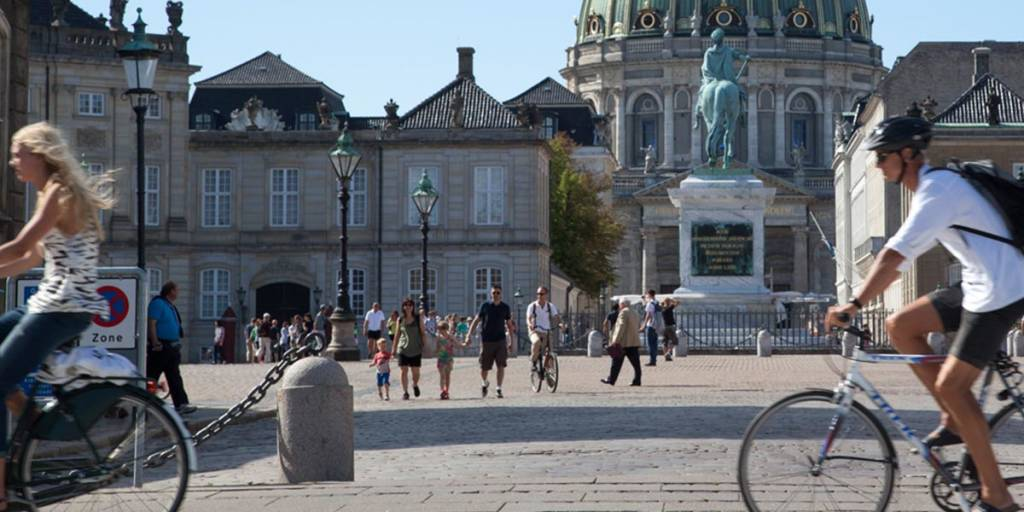 Amalienborg Castle in Copenhagen - people cycling