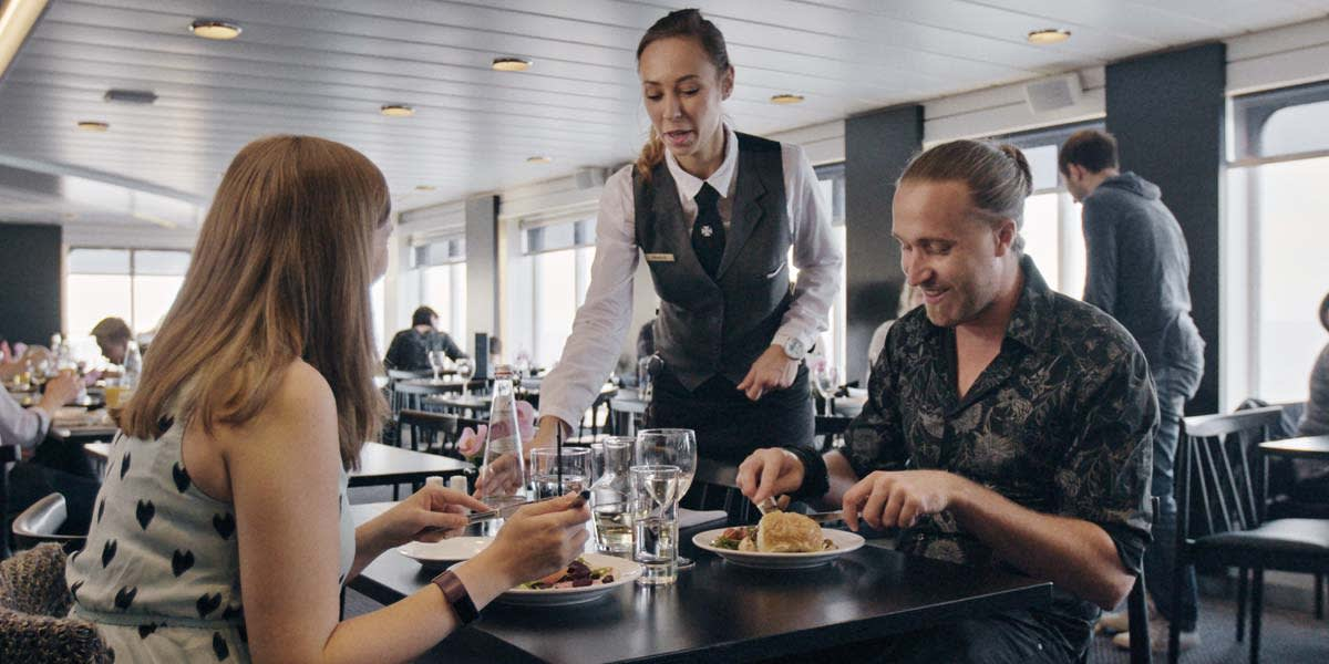 Couple dining in Explorers Kitchen onboard Newcastle-Amsterdam